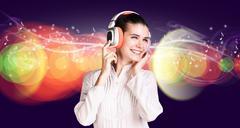 woman enjoying music on headphones - stock photo