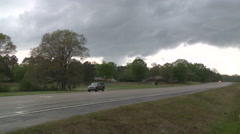 Police Car with Sirens Speeds Down Highway after Storms Cause Damage Stock Footage