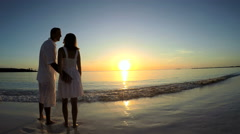 Stock Video Footage of Young Caucasian male female couple kiss on luxury vacation beach