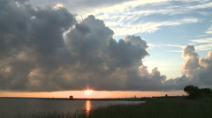 Towering Cumulus at Sunset on Mobile Bay Stock Footage