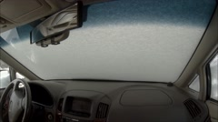4K Clip from Inside Car Starting on Snowy Monring Stock Footage