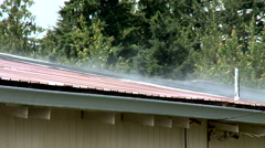 Rain Water Evaporates to Steam on a Hot Roof in Sun - stock footage