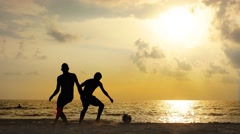 Soccer World Cup Fever - Silhouette of Men Playing Football on the Beach at S Stock Footage