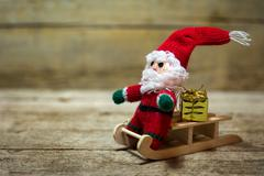 Santa puppet on a wooden sledge - stock photo
