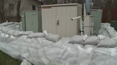 Sandbags Protect Utility Sheds While Awaiting a Flood Stock Footage