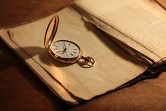 Vintage pocket watch closeup Stock Photos