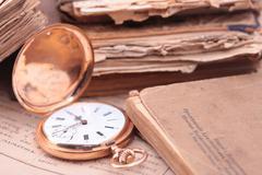 Vintage pocket watch and a books closeup Stock Photos