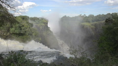 Mists Rising into Jungle Around Cataracts of Victoria Falls, Zimbabwe Stock Footage