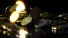Coins of various currencies and value falling down, slow motion. Stock Footage
