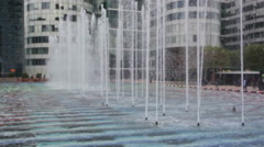 Close up view at playing fountains near La Grande Arche Stock Footage