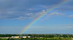 4K of Rainbow over Shopping Center Stock Footage