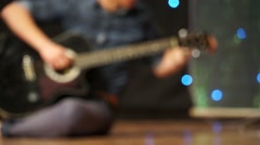 Stock Video Footage of man tuning Guitar