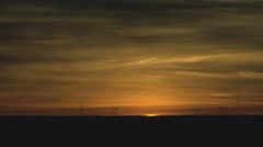 Time Lapse of Distorted Solar Disk at Sunrise Stock Footage