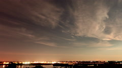 4K Night Time Lapse of Cirrus Clouds Above CIty Lights Stock Footage