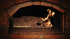 Making a pizza  in a wood burning oven. Stock Footage