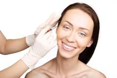 Plastic surgery, a woman in the clinic of aesthetic surgery Stock Photos