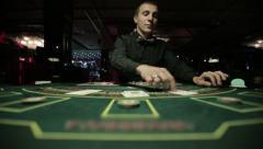 Dealer plays blackjack in casino Stock Footage