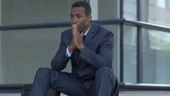 Upset and sad businessman: African american businessman worried on the steps Stock Footage