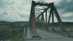 Old metal and wooden bridge Stock Footage
