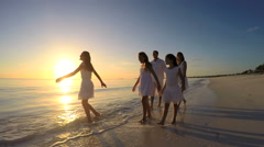 Loving male female Caucasian family on tropical beach at sunset Stock Footage