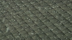 First Snow Flakes Falling On Shingle Roof Stock Footage