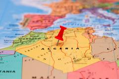 Map of Algeria with a red pushpin stuck - stock photo