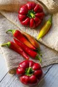 red paprika and pepper on a wooden table - stock photo