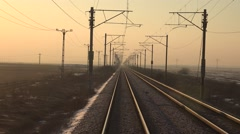 Stock Video Footage of 4K POV Point of view train infrastructure orange sunlight morning winter daytime
