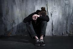 Concept for drug addiction and despair - stock photo