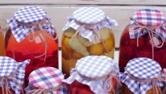 Glass jars with preservation. Stock Footage