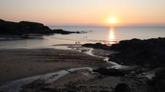 Sunset beach Treyarnon Bay Cornwall England UK with people Stock Footage