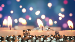 Burning candles and bokeh lights loopable Stock Footage