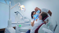 Two dentists making a patient examination Stock Footage