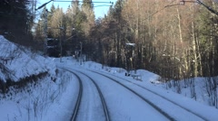 Stock Video Footage of 4K POV Point of view train slow speed mountain curve line forest cold winter day
