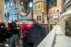 tourists visit famous cathedral in Monreale - stock photo