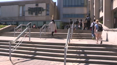 Diverse college and university students on campus on sunny summer day in Toronto Stock Footage