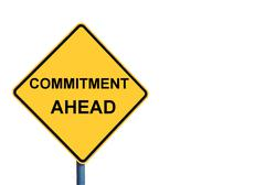 Yellow roadsign with COMMITMENT AHEAD message - stock photo
