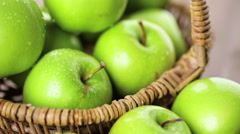 Organic Granny Smith apples on the table. - stock footage