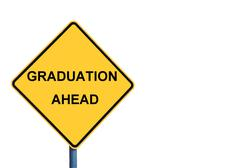 Yellow roadsign with GRADUATION AHEAD message Stock Photos
