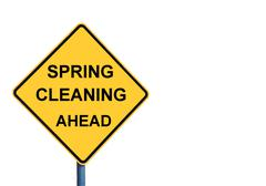 Yellow roadsign with SPRING CLEANING AHEAD message - stock photo