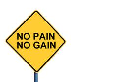 Yellow roadsign with NO PAIN NO GAIN message - stock photo