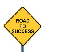 Yellow roadsign with ROAD TO SUCCESS message - stock photo