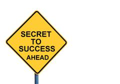 Yellow roadsign with SECRET TO SUCCESS AHEAD message - stock photo