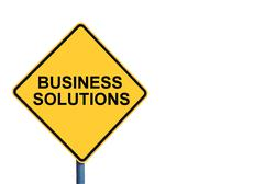 Yellow roadsign with BUSINESS SOLUTIONS message - stock photo