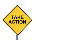 Yellow roadsign with TAKE ACTION message - stock photo
