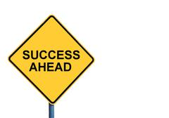 Yellow roadsign with SUCCESS AHEAD message - stock photo