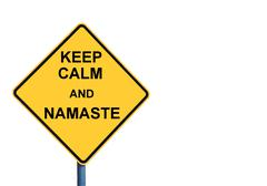 Stock Photo of Yellow roadsign with KEEP CALM AND NAMASTE message