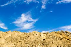 Excavated Mud and Blue Sky - stock photo