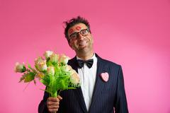 Nerd man with lipstick face marks Valentines Day - stock photo