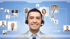 Businessman in headset over contacts icons Kuvituskuvat